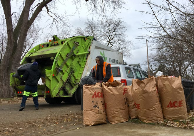 Bags of leaves on Wall Street await pickup by Emterra crews on Wednesday, Nov. 28, 2018, in Port Huron. Residents in the city have complained about the delay and performance in leaf pickup this year. As an alternative to raking piles, leaves can also be put in yard waste bags or containers with an X for pickup on regular trash collection days through Dec. 14.