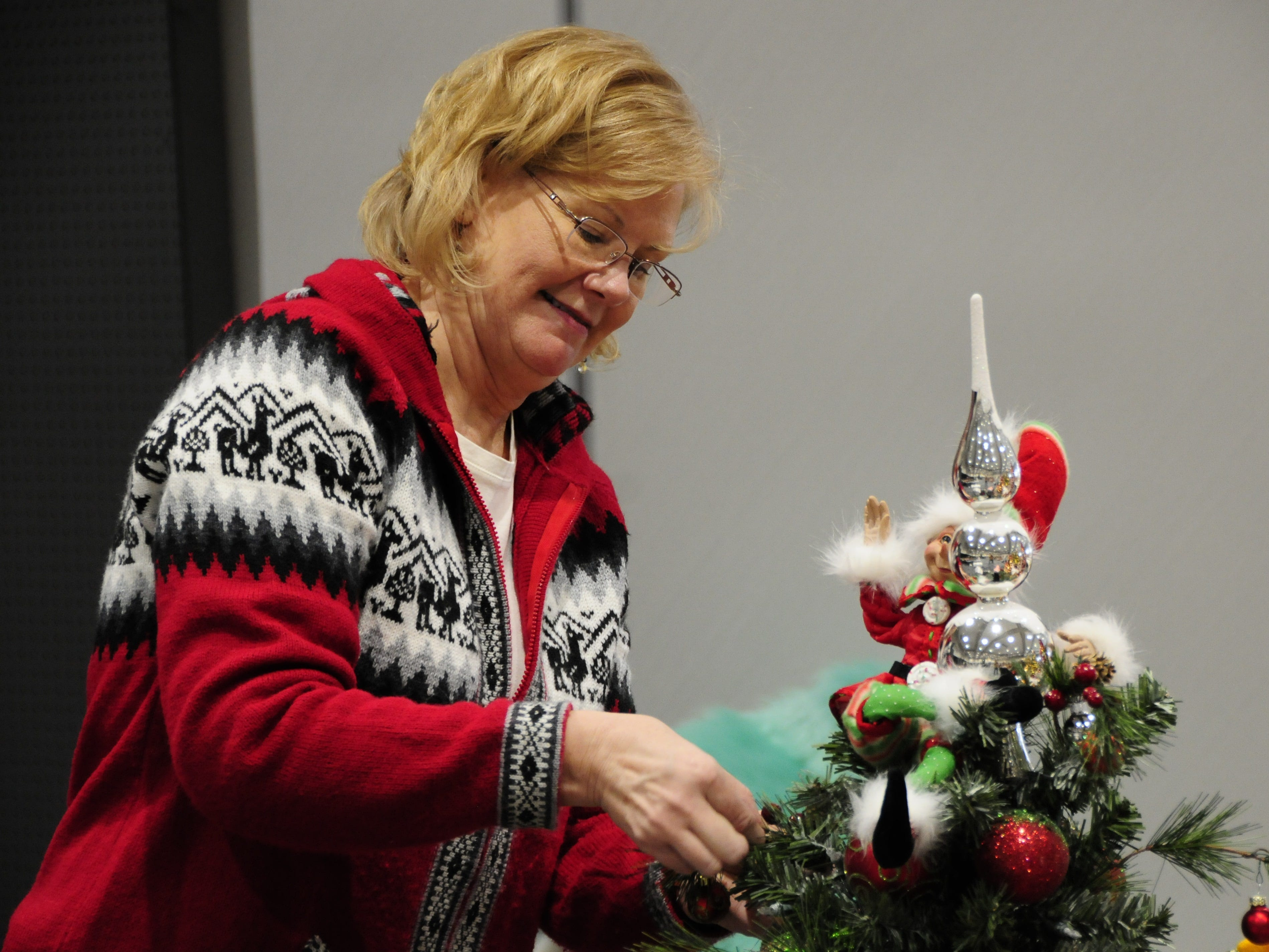Becky Ziemianski works on a Christmas tree Wednesday for the Festival of Trees, Friday through Sunday at the Blue Water Convention Center.