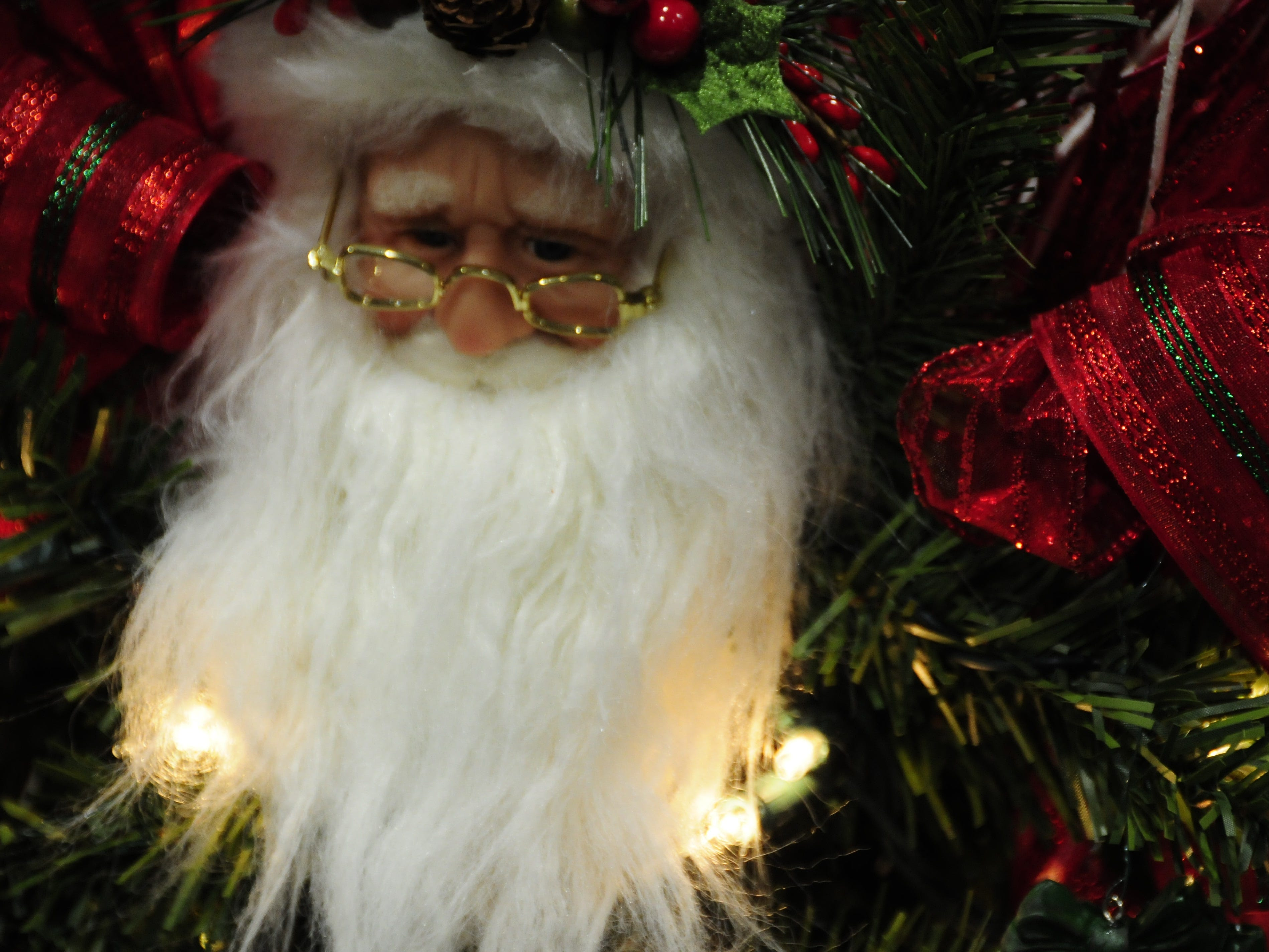 A lifelike Santa figure decorates a tree at the Festival of Trees, Friday through Sunday at the Blue Water Convention Center.