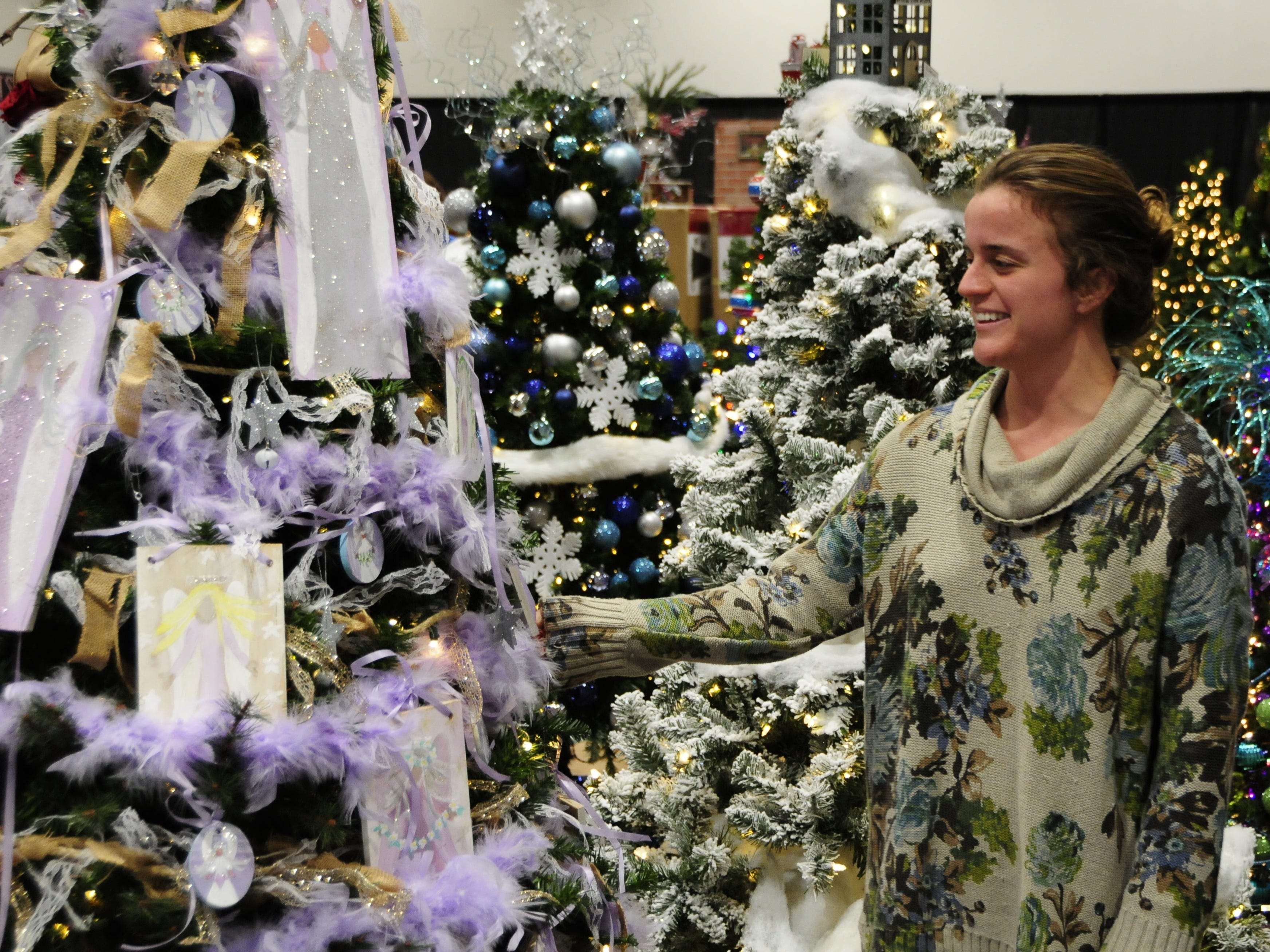 Jacqueline Gutenkunst admires a tree Wednesday during preparations for the Festival of Trees, Friday through Sunday at the Blue Water Convention Center.