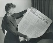 Eleanor Roosevelt holds a poster of the Universal Declaration of Human Rights in Lake Success, NY, in November 1949.