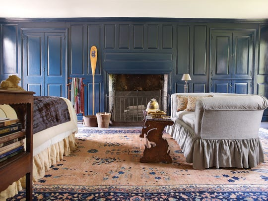 """THE BOUWERIE: One of the Hudson Valley estates features in  """"""""Life Along The Hudson: The Historic Country Estates of the Livingston Family,"""" (Rizzoli) by Pieter Estersohn. The original 1762 Dutch paneling in the bedroom is  painted Prussian blue, a pigment invented in 1704."""