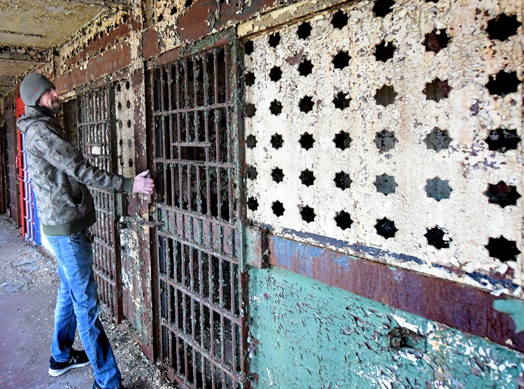 Think Loud building manager Scott Gracey finds a working cell door while touring the former York County Prison on Chestnut Street in York City Wednesday, Nov. 28, 2018. United Fiber and Data has purchased the building and plans to incorporate the structure into a data center to accompany a 400-mile fiber-optic network it's building between New York and Virginia. Bill Kalina photo