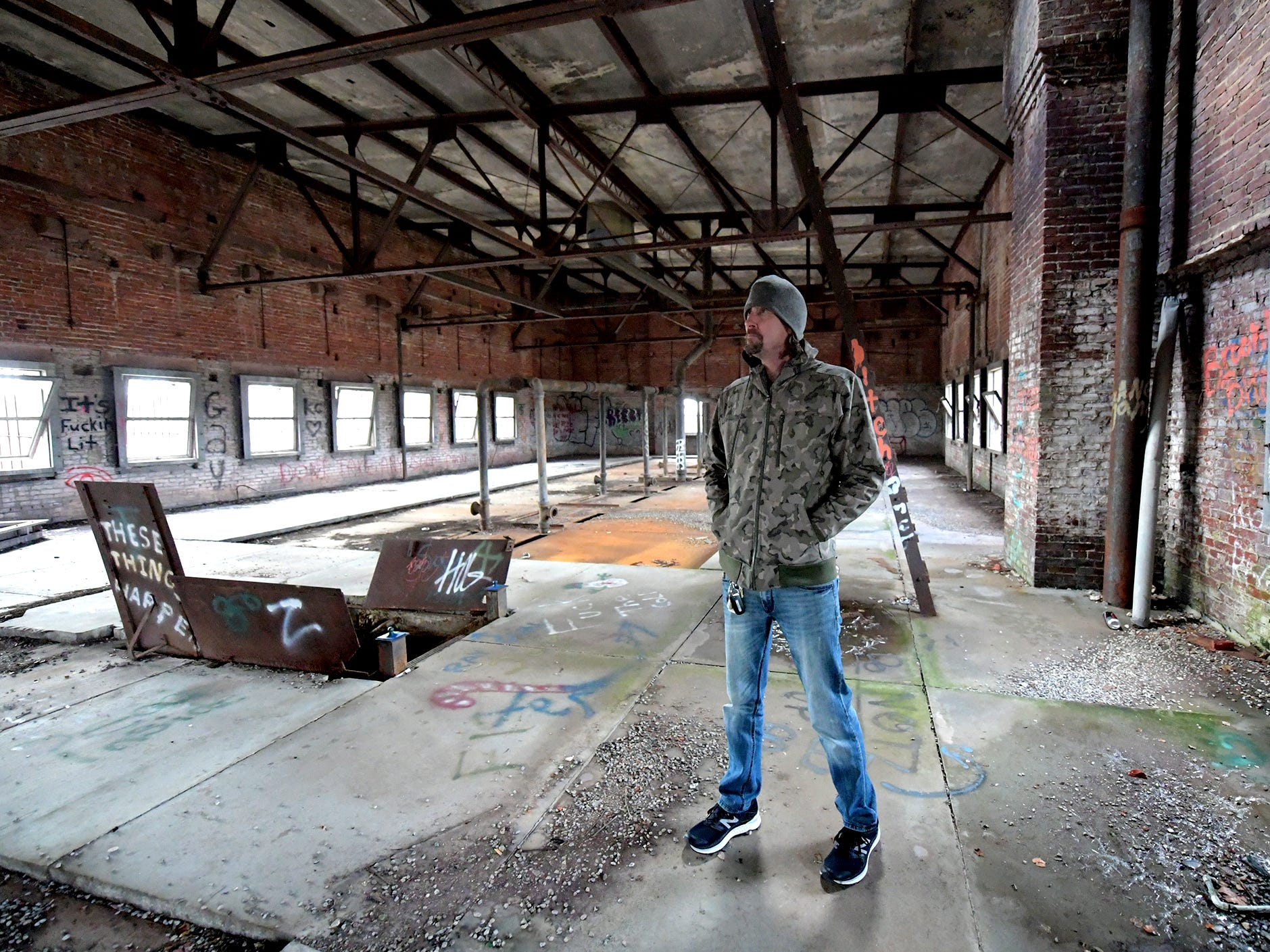 Think Loud building manager Scott Gracey stands in the open top floor of the former York County Prison on Chestnut Street in York City Wednesday, Nov. 28, 2018. United Fiber and Data has purchased the building and plans to incorporate the structure into a data center to accompany a 400-mile fiber-optic network it's building between New York and Virginia. Bill Kalina photo