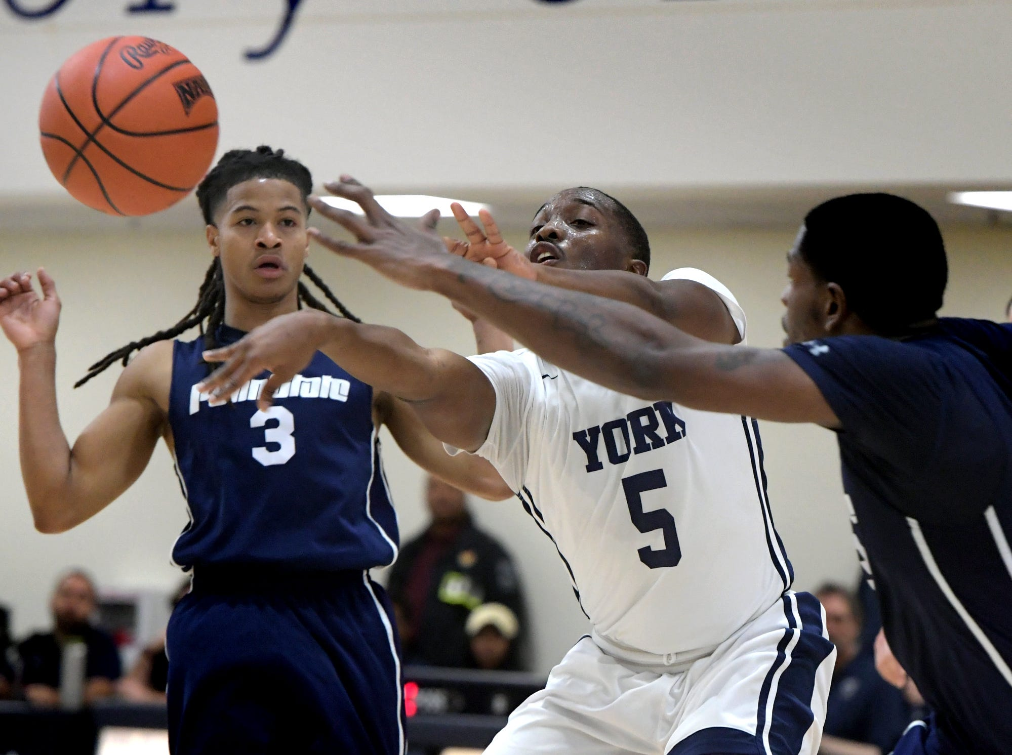 Penn State York's Larry Roscoe gets a pass away with Penn State Wilkes-Barre's Jayden Hampton, left, and Davaughn Roberts defending during action in York Tuesday, Nov. 27, 2018. Bill Kalina photo