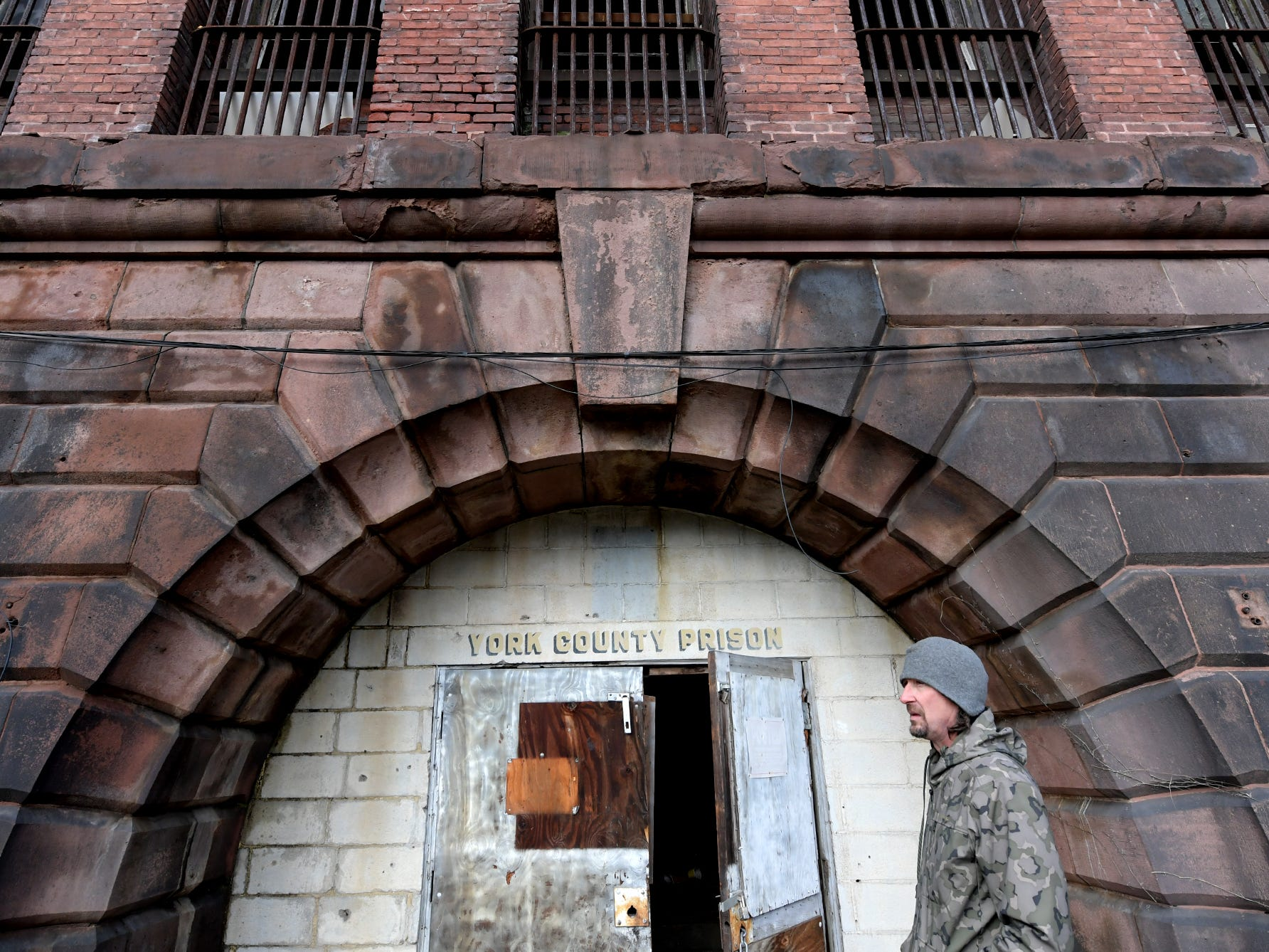 Think Loud building manager Scott Gracey stands at the entrance of the former York County Prison on Chestnut Street in York City Wednesday, Nov. 28, 2018. United Fiber and Data has purchased the building and plans to incorporate the structure into a data center to accompany a 400-mile fiber-optic network it's building between New York and Virginia. Bill Kalina photo