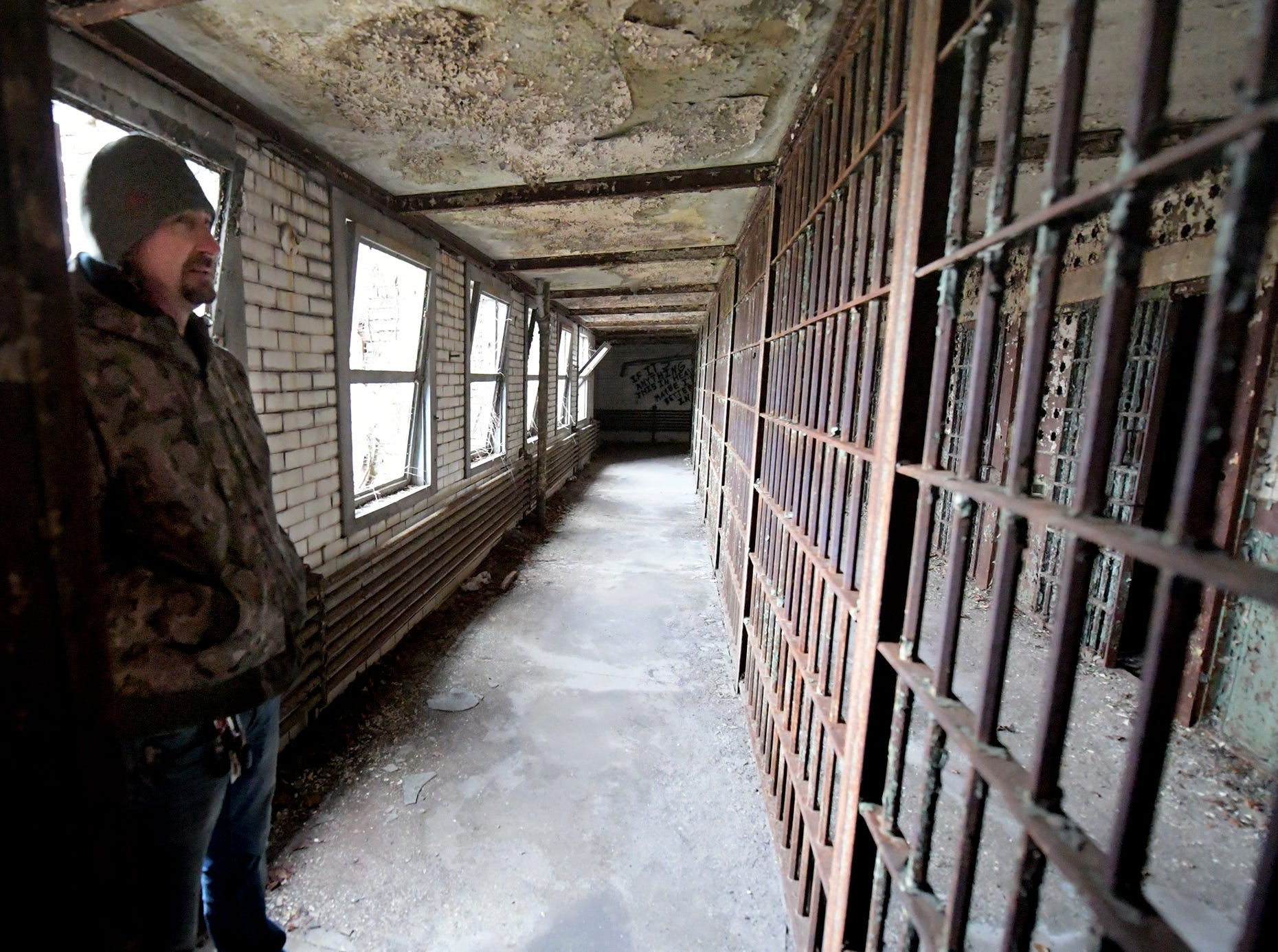 Think Loud building manager Scott Gracey tours the former York County Prison on Chestnut Street in York City Wednesday, Nov. 28, 2018. United Fiber and Data has purchased the building and plans to incorporate the structure into a data center to accompany a 400-mile fiber-optic network it's building between New York and Virginia. Bill Kalina photo