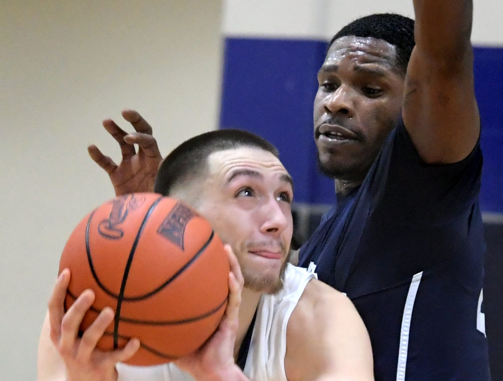 Penn State York's Chris Pitcher looks for the basket with pressure from Penn State Wilkes-Barre's Davaughn Roberts during action in York Tuesday, Nov. 27, 2018. Bill Kalina photo