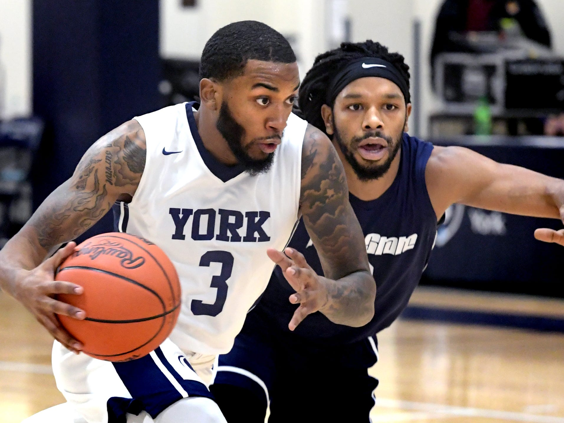 Penn State York's Anthony Bennett, Jr. drives with Penn State Wilkes-Barre's Ameer Biddle defending during action in York Tuesday, Nov. 27, 2018. Bill Kalina photo