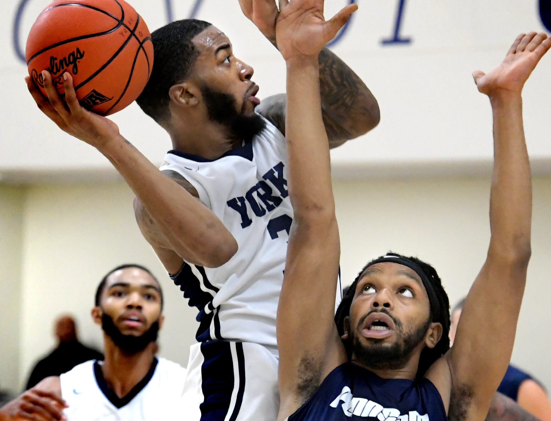 Penn State York's Anthony Bennett, Jr. drives over Penn State Wilkes-Barre's Ameer Biddle during action in York Tuesday, Nov. 27, 2018. Bill Kalina photo