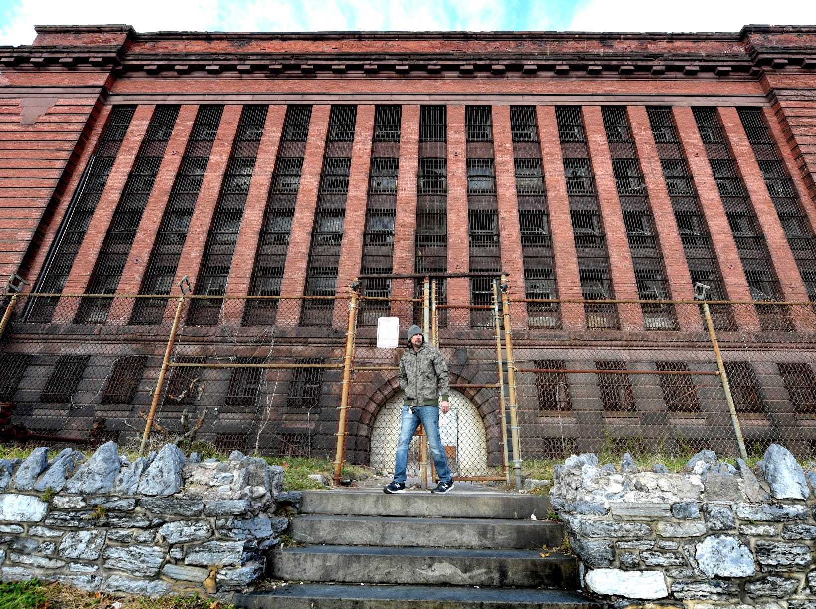 Think Loud building manager Scott Gracey leaves the  former York County Prison on Chestnut Street in York City Wednesday, Nov. 28, 2018. United Fiber and Data has purchased the building and plans to incorporate the structure into a data center to accompany a 400-mile fiber-optic network it's building between New York and Virginia. Bill Kalina photo