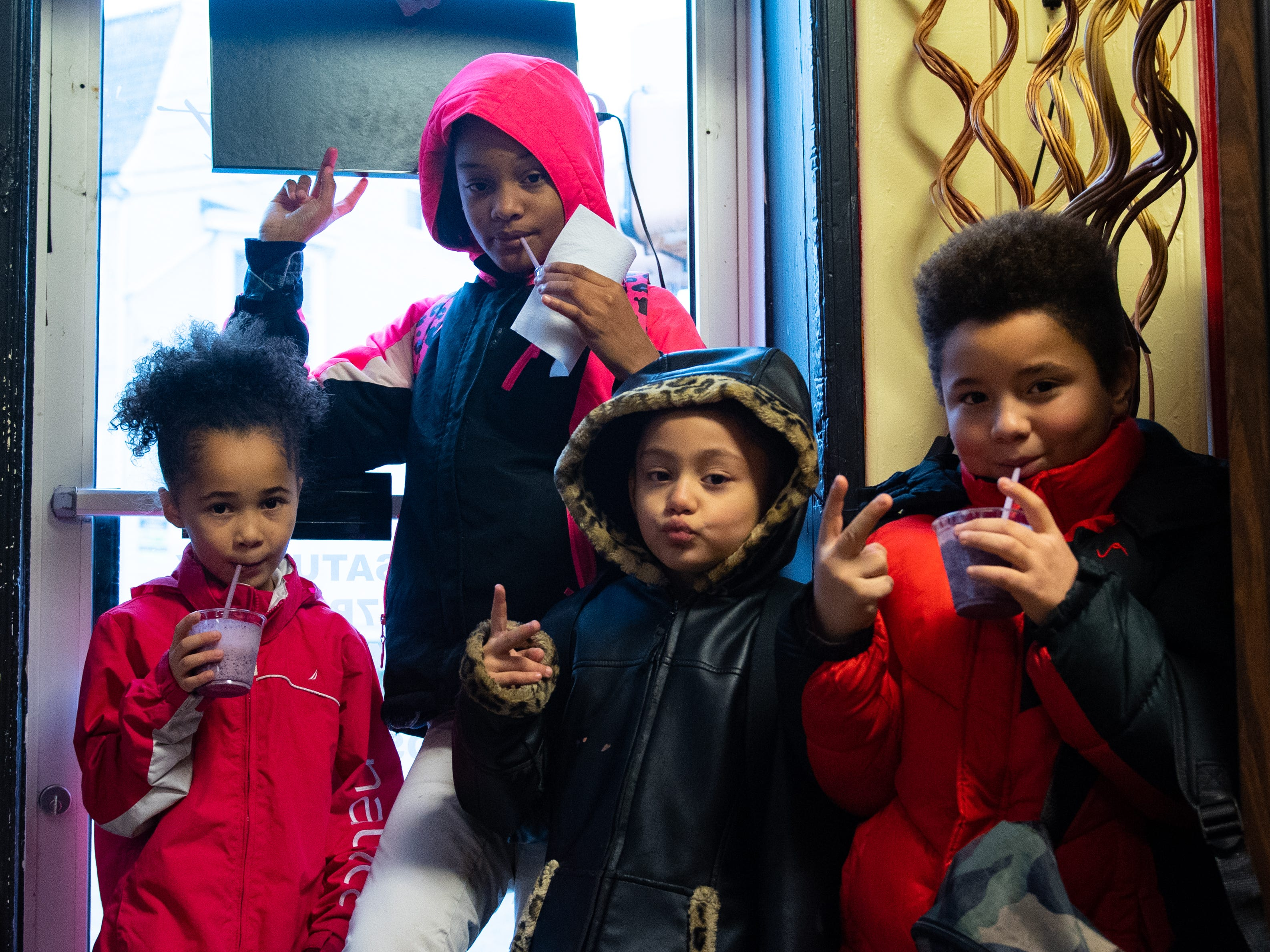 The young customers are all smiles as they suck down their frozen treats at Cornbread West, November 27, 2018.