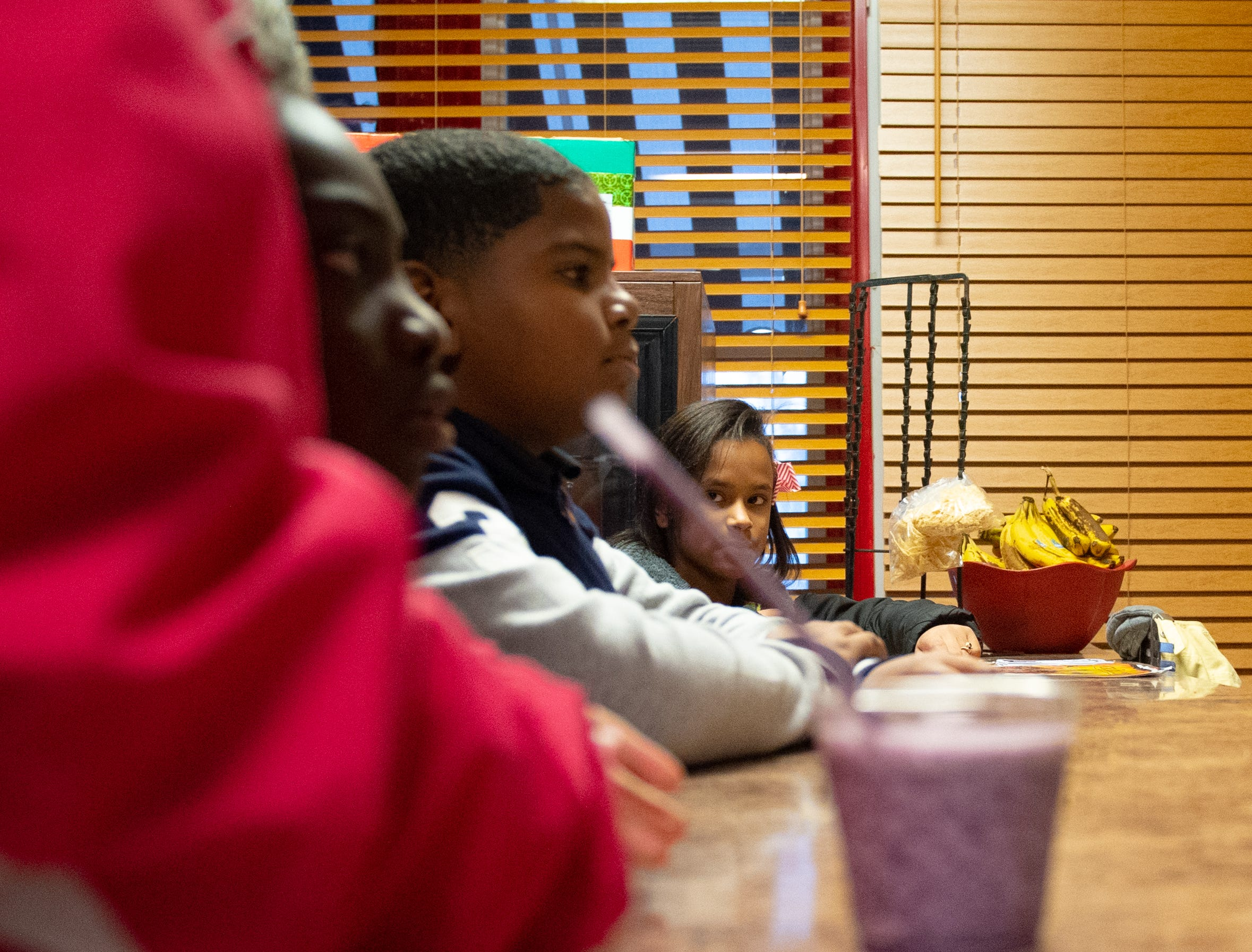 The elementary schools wait patiently for their smoothies to be made, November 27, 2018.