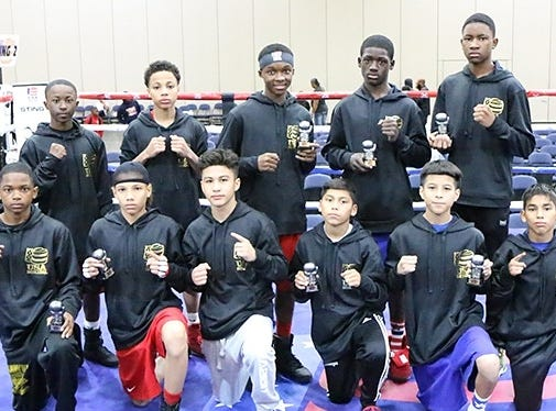 Antwoine Dorm Jr., front row second from left, poses after a recent amateur boxing tournament.