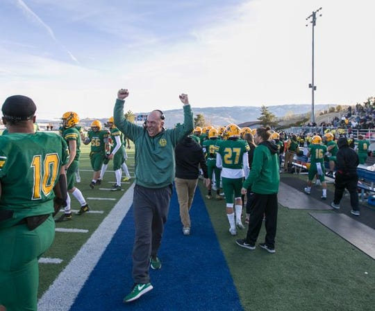 The Bishop Manogue sideline on Saturday during the state semifinal football game at McQueen.