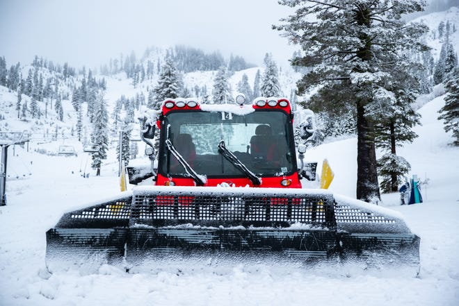 A snowcat vehicle grooms trails at Alpine Meadows on Wednesday, Nov. 28, 2018 after the first of three expected storms hit the Sierra.