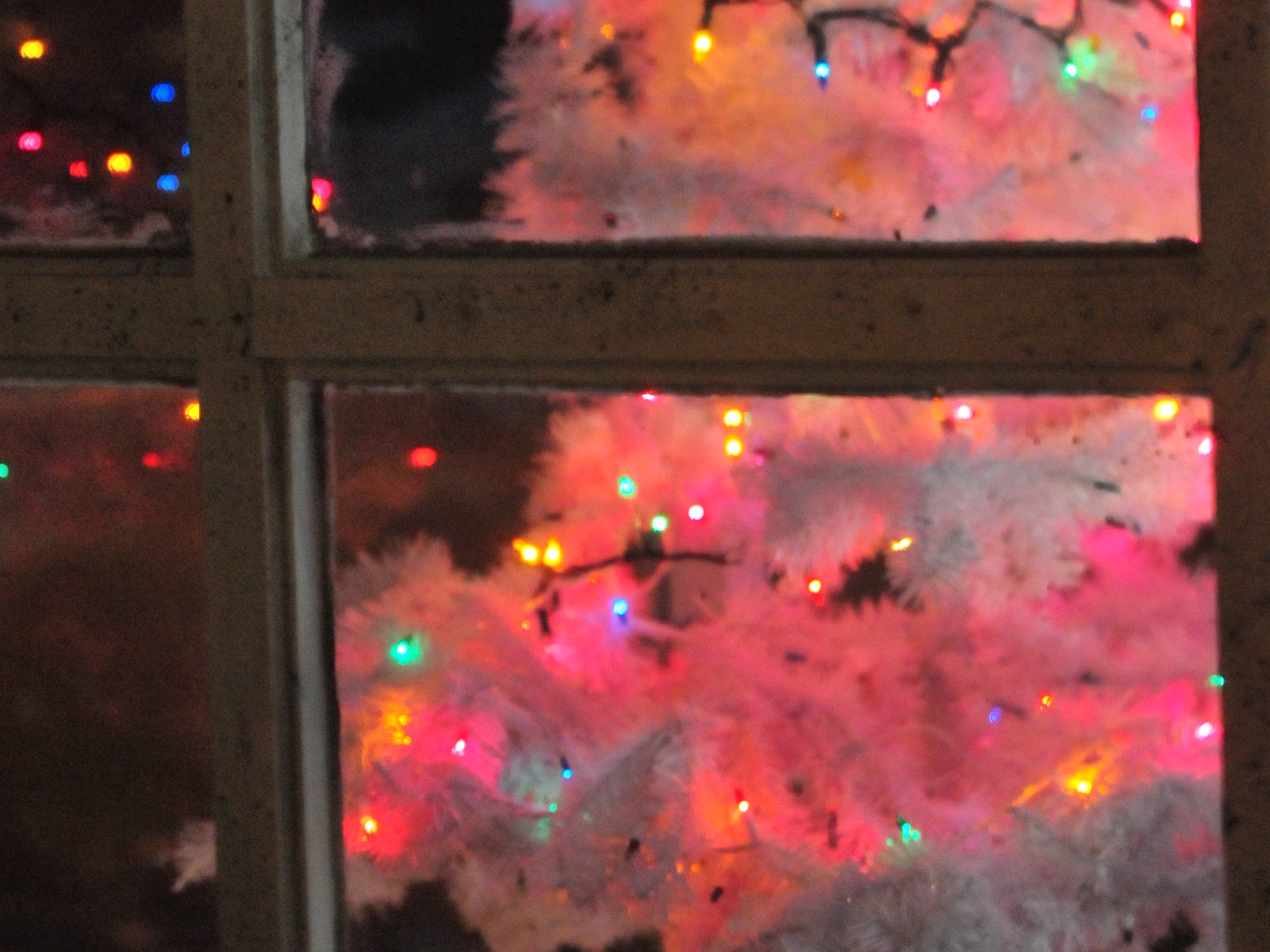 A Depot District store window is decorated Tuesday during the 14th annual Old-Fashioned Christmas Festival.