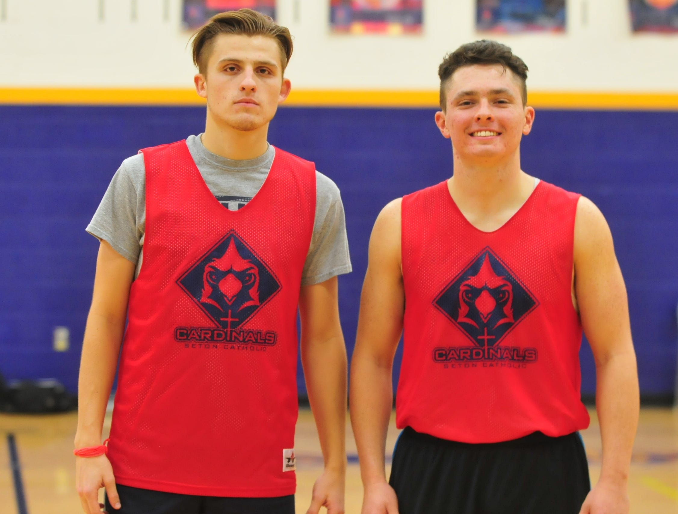 Seton Catholic boys basketball seniors Sam Brenneke, left, and Trent Reichley during practice Wednesday, Nov. 28, 2018.