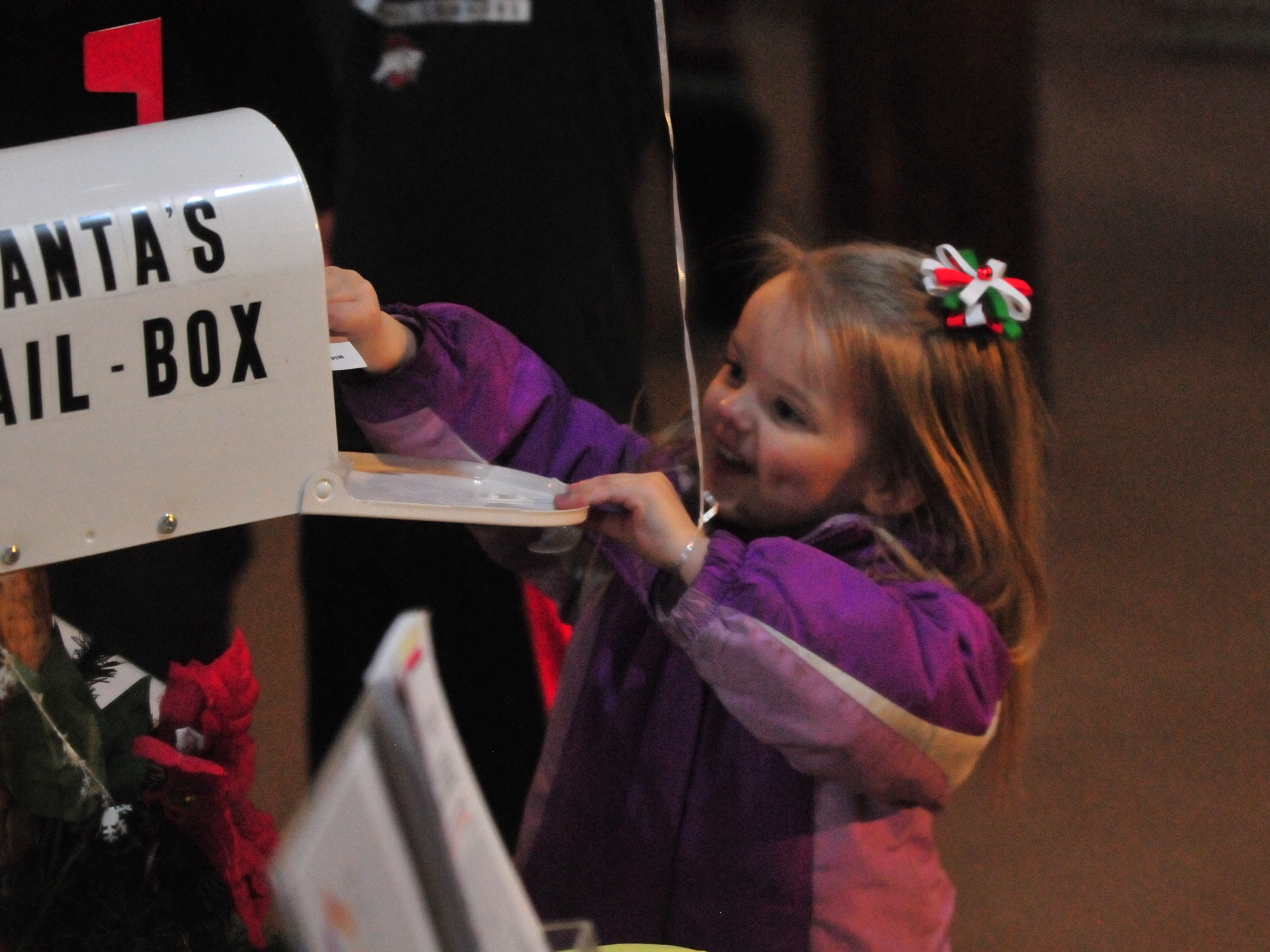 Hayley Knaus, 3, mails her letter to Santa during Tuesday's 14th annual Old-Fashioned Christmas Festival.