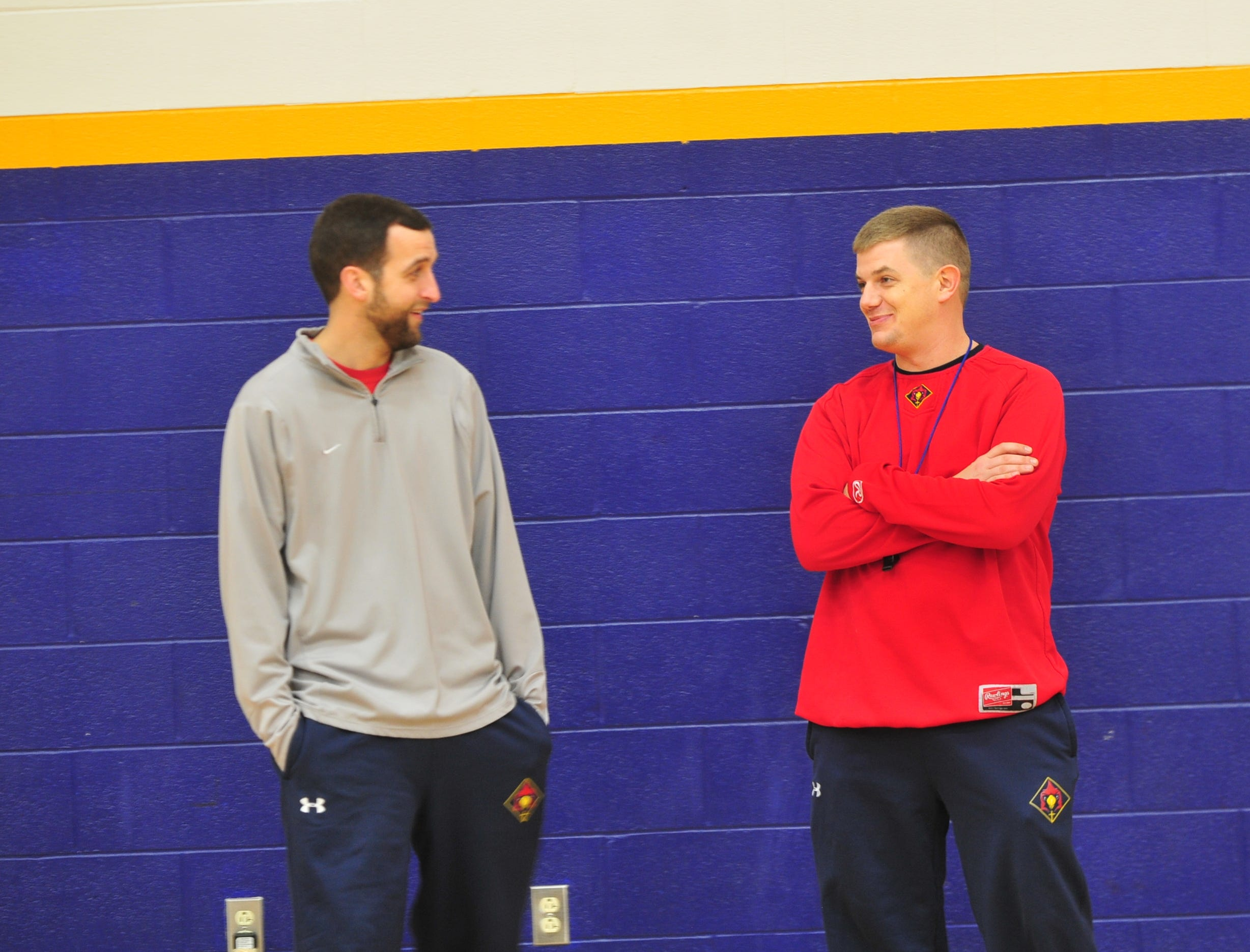 Seton Catholic boys basketball assistant coach Jon Blevins, left, with head coach Josh Jurgens.
