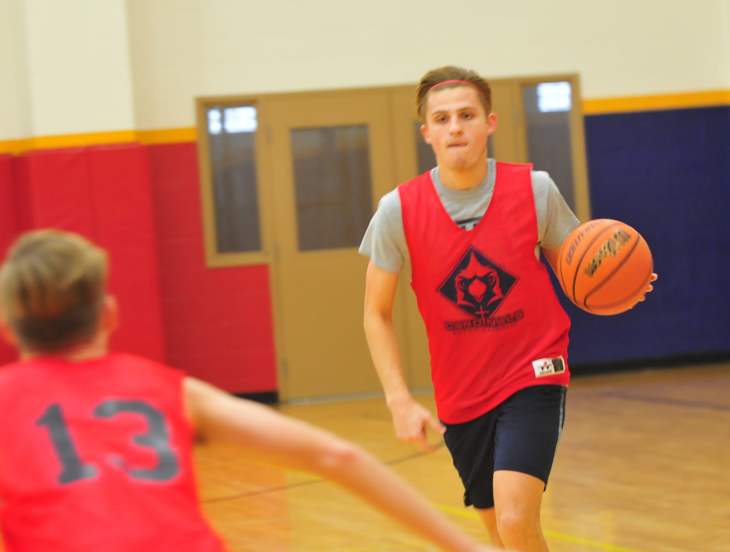 Seton Catholic basketball player Sam Brenneke moves the ball during practice Wednesday, Nov. 28, 2018.