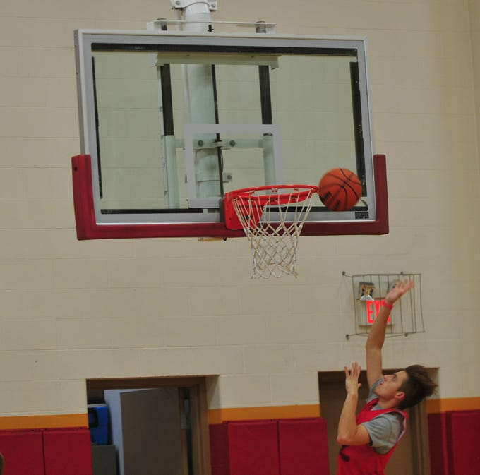Seton Catholic boys basketball player Sam Brenneke shoots a layup in practice Wednesday, Nov. 28, 2018.
