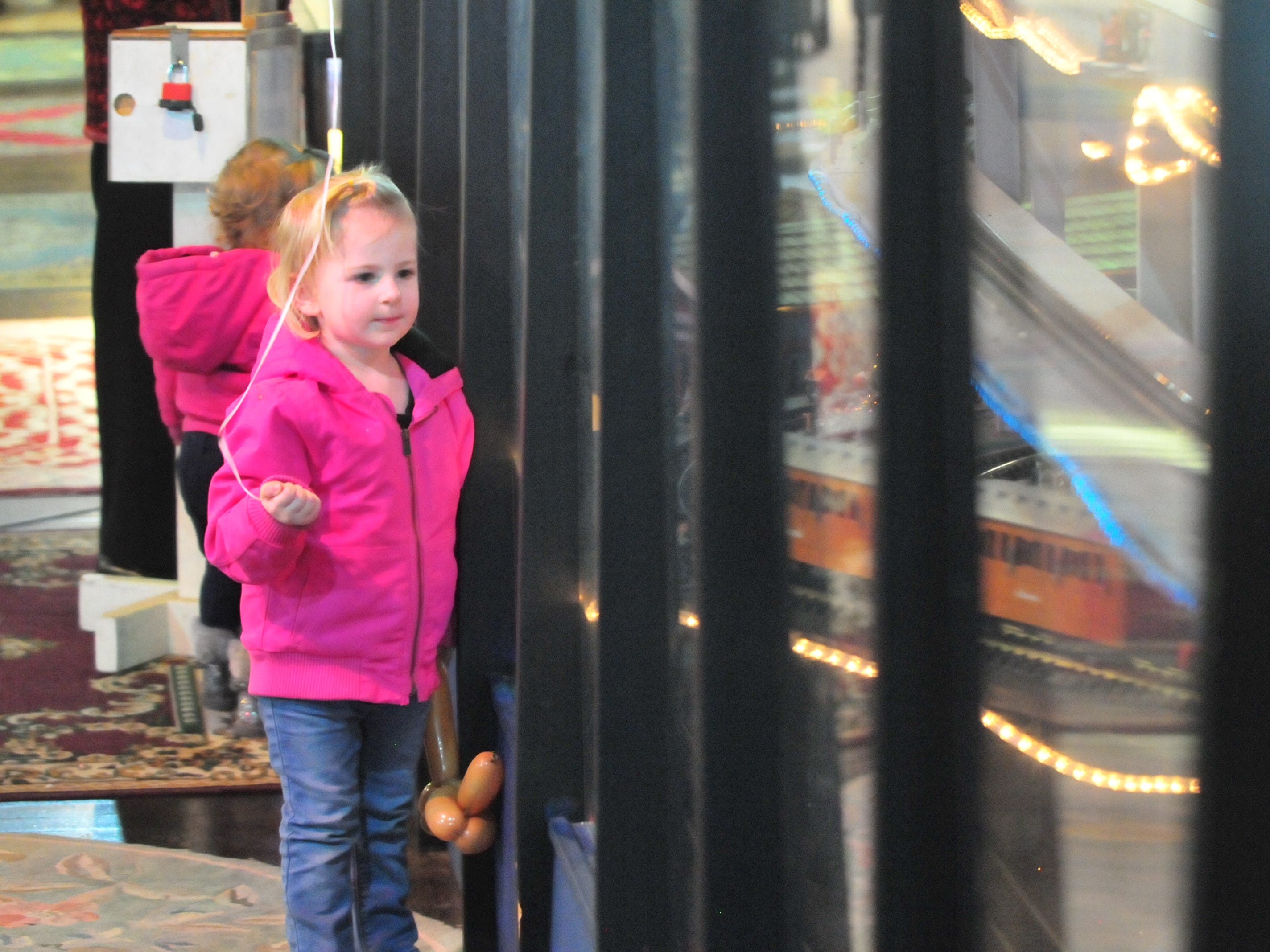 Model trains ran through a display Tuesday during the 14th annual Old-Fashioned Christmas Festival.