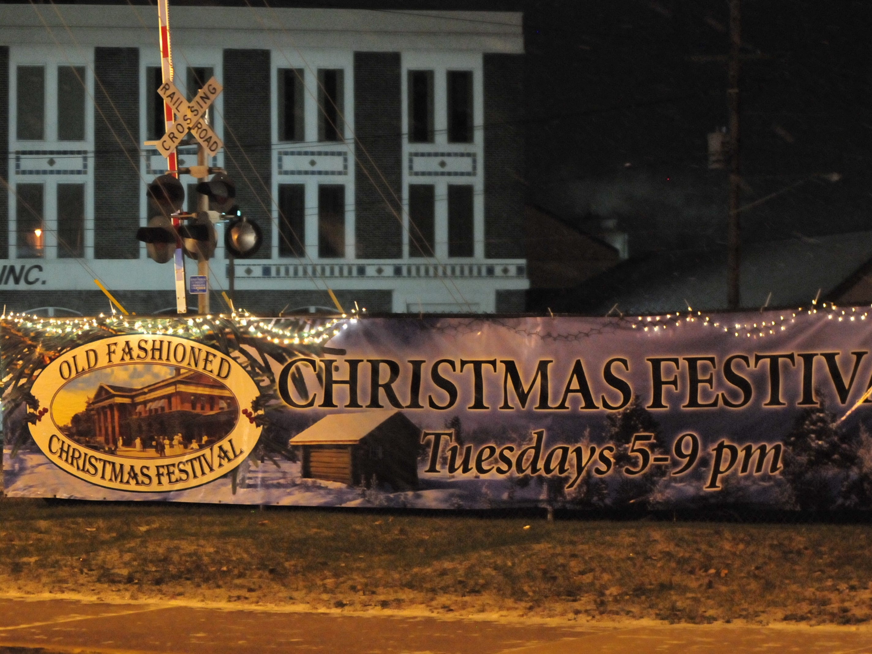 Lights and a banner advertise the Old-Fashioned Christmas Festival that began Tuesday and continues Dec. 4 and 11 in the Depot District.
