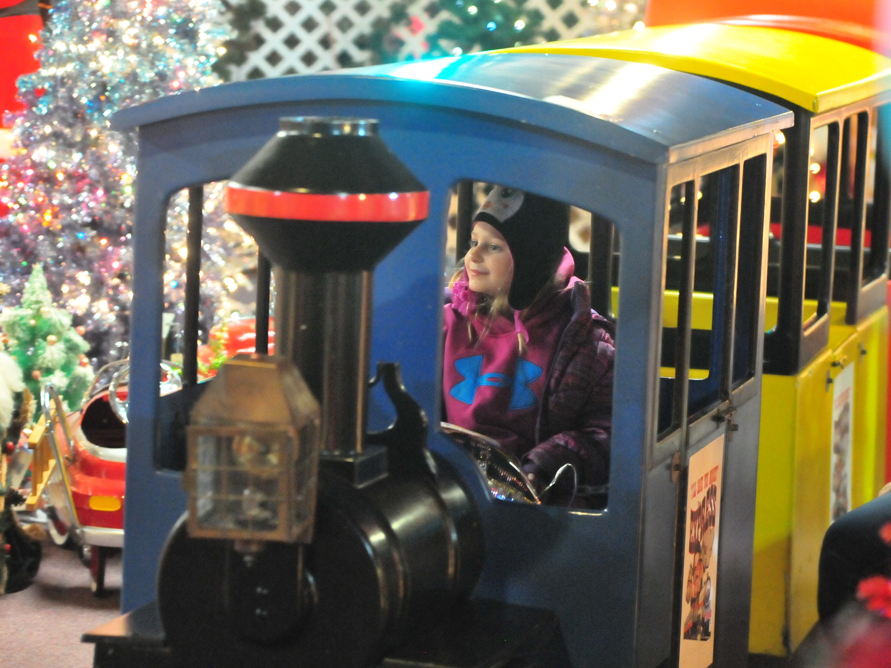 Children could ride a train Tuesday during the 14th annual Old-Fashioned Christmas Festival.