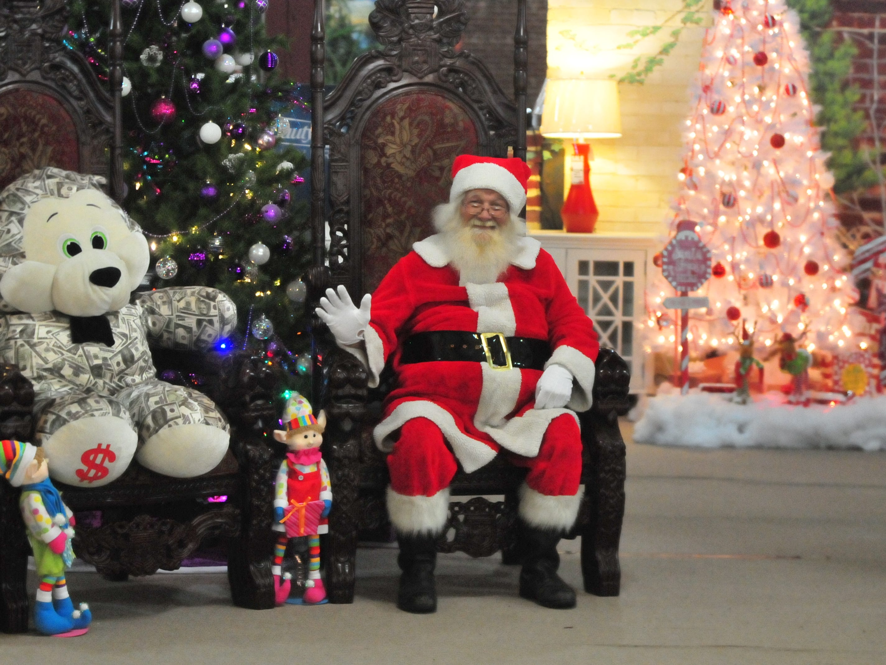 Santa waits for his next visitor Tuesday during the 14th annual Old-Fashioned Christmas Festival.