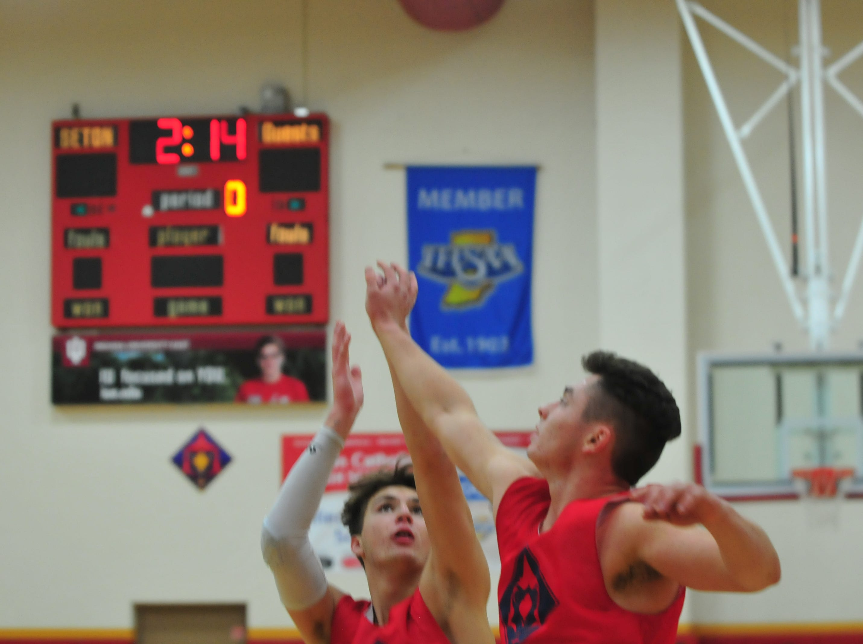 Seton Catholic sophomore Jake Moynihan takes a shot while being guarded by Trent Reichley during practice Wednesday, Nov. 28, 2018.