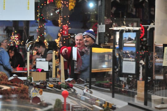 Model trains run through a display at the Old-Fashioned Christmas Festival in 2018.