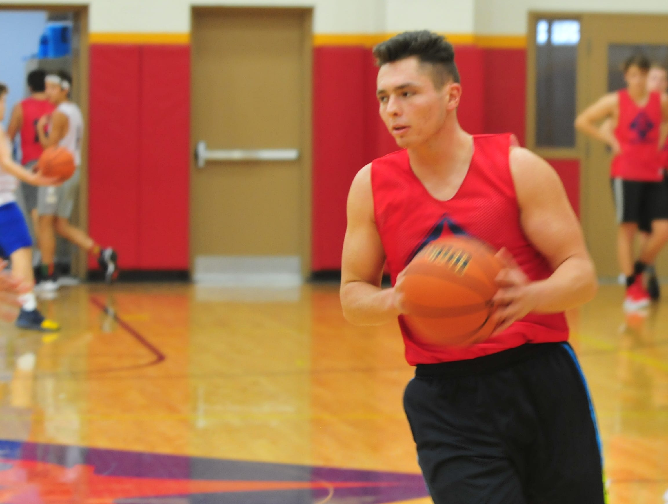 Seton Catholic senior Trent Reichley handles the ball during practice Wednesday, Nov. 28, 2018.