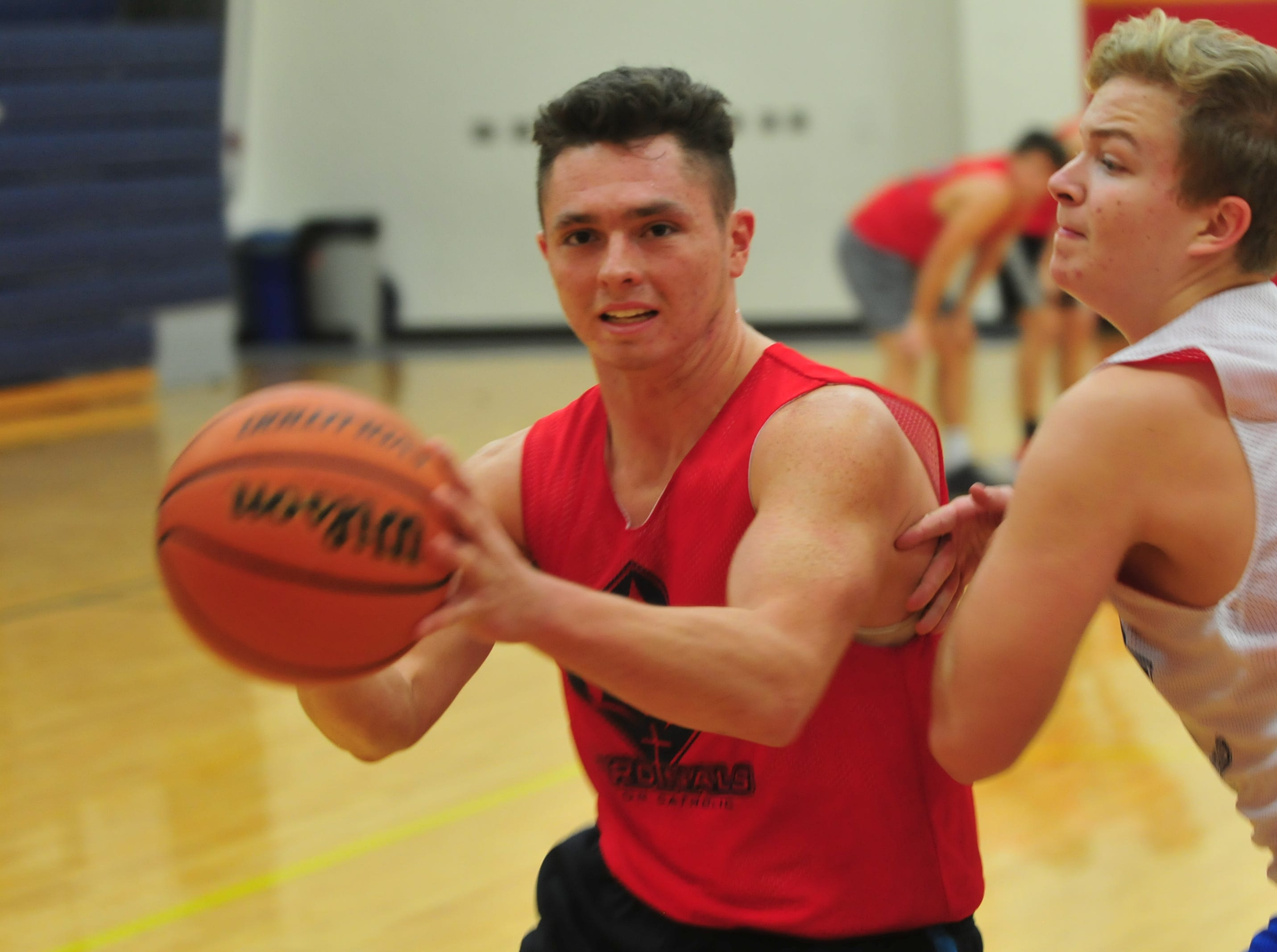 Seton Catholic boys basketball senior Trent Reichley moves to the basket during practice Wednesday, Nov. 28, 2018.