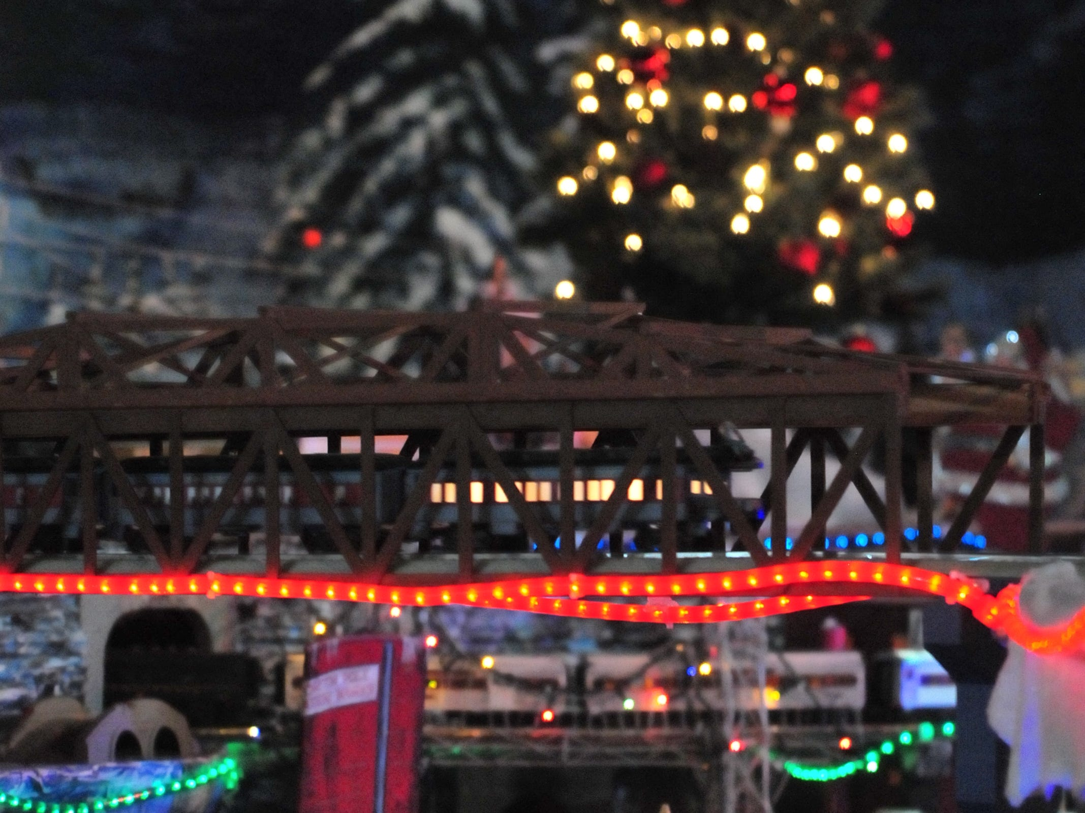Model trains run through a display Tuesday during the 14th annual Old-Fashioned Christmas Festival.