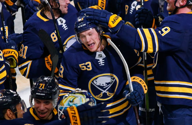 Buffalo Sabres forward Jeff Skinner (53) celebrates his game-winning goal following the overtime period of an NHL hockey game against the San Jose Sharks, Tuesday, Nov. 27, 2018, in Buffalo N.Y. (AP Photo/Jeffrey T. Barnes)