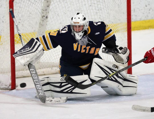 Victor goalie Pieter Bartelse makes a save against Penfield.