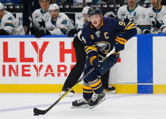 Buffalo Sabres forward Jack Eichel (9) controls the puck during the third period of an hockey game against the San Jose Sharks, Tuesday, Nov. 27, 2018, in Buffalo N.Y. (AP Photo/Jeffrey T. Barnes)