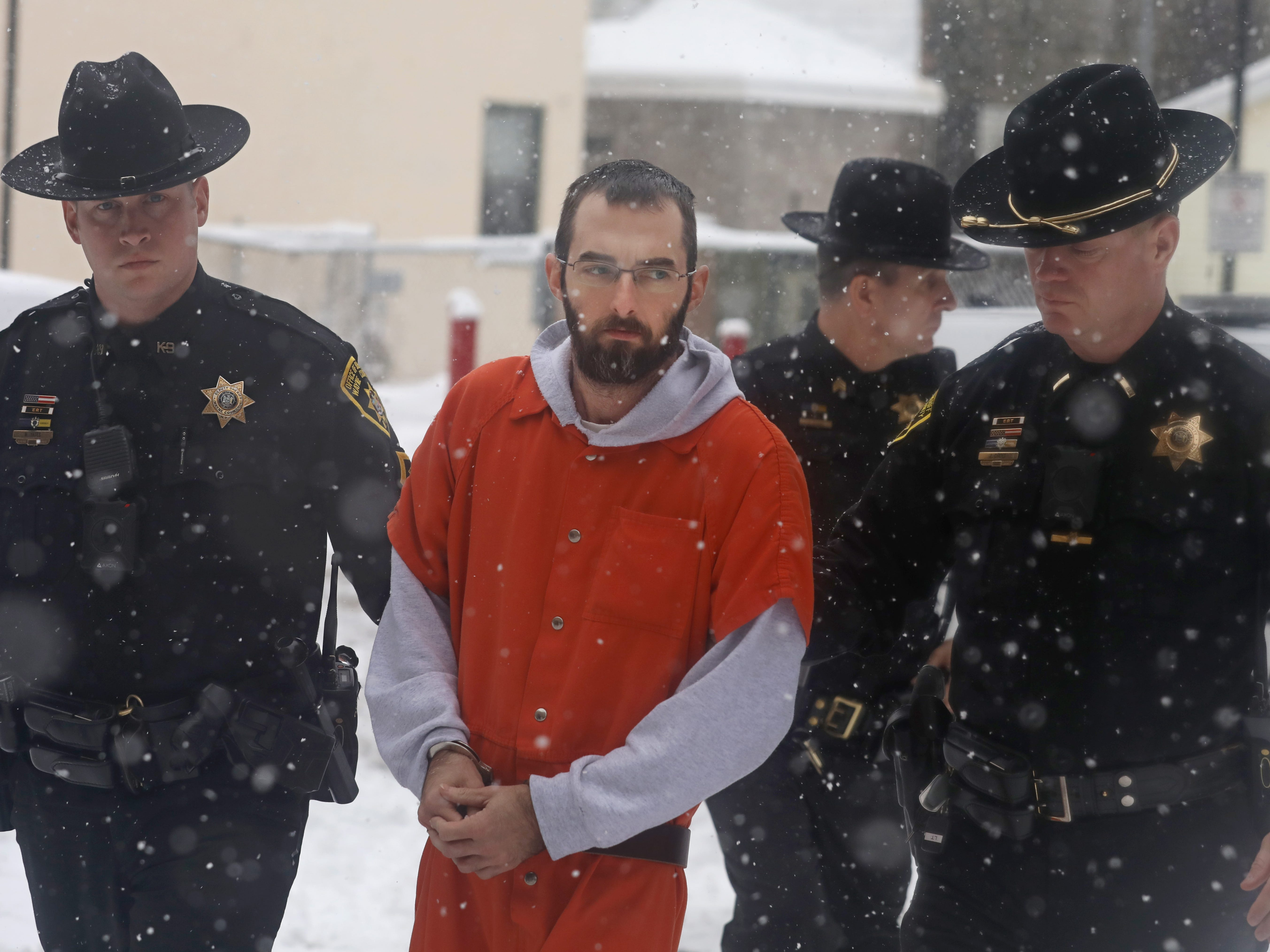 Timothy Dean is lead to his hearing at the Wayne County Courthouse in Lyons Wednesday, Nov. 28, 2018.