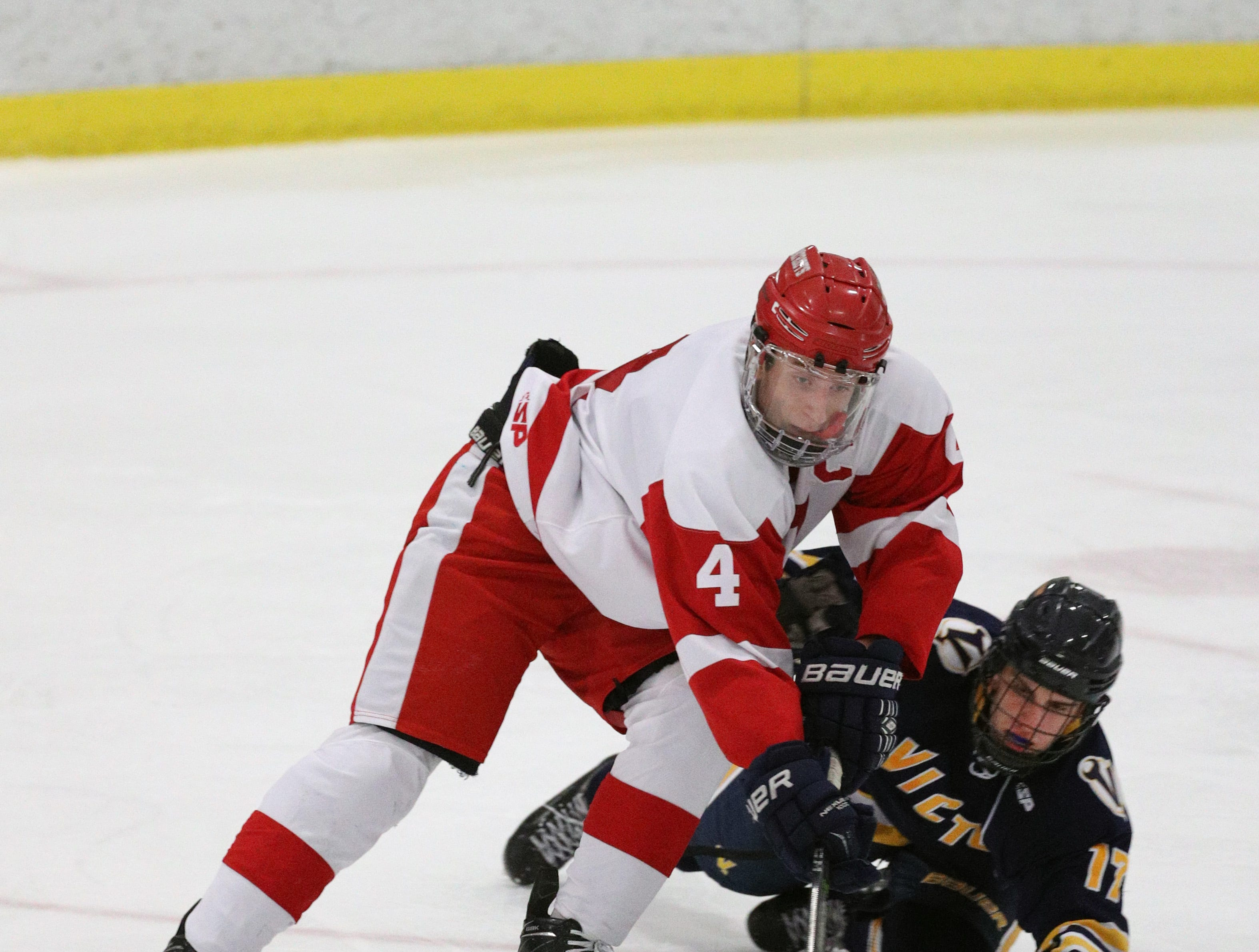 Penfield's Jack Schlifke tries to carry the puck around Roman Czornobil.