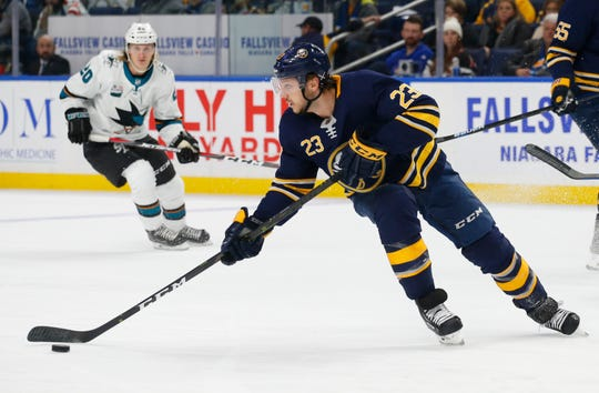 Buffalo Sabres forward Sam Reinhart (23) controls the puck during the first period of an NHL hockey game against the San Jose Sharks, Tuesday, Nov. 27, 2018, in Buffalo N.Y. (AP Photo/Jeffrey T. Barnes)