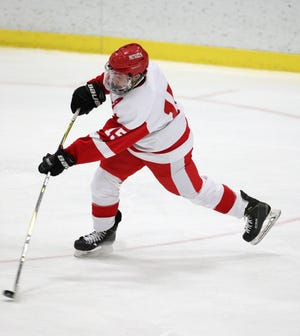 Penfield's Bobby Bradley gets off a shot against Victor.