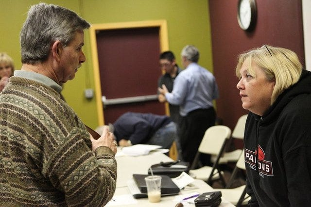 In April 2011, Kathy White talks to Frank Strazzarino Jr. At the time, he was president of the Greater Redding Chamber of Commerce. They were at a meeting of the Redding Safe Camp Homeless Alliance that White helped start.