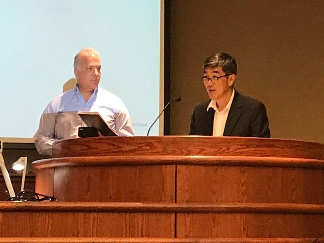 Mike Okuma, of Costco, right, and Greg Vena, of Rich Development, address the Redding Planning Commission at a July 23, 2019, meeting.