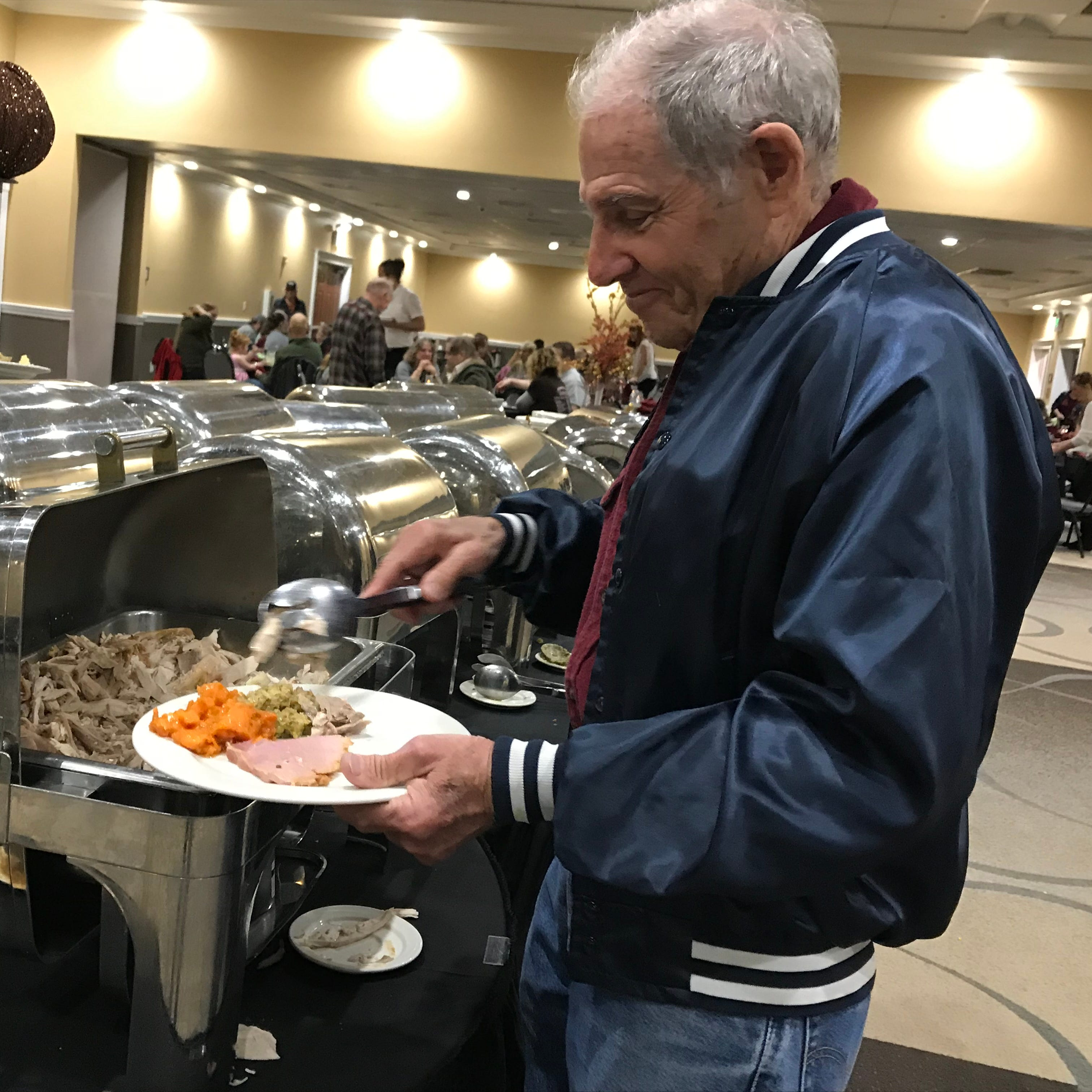 More than 750 people displaced by Carr, Camp wildfires treated to Thanksgiving meal, camaraderie