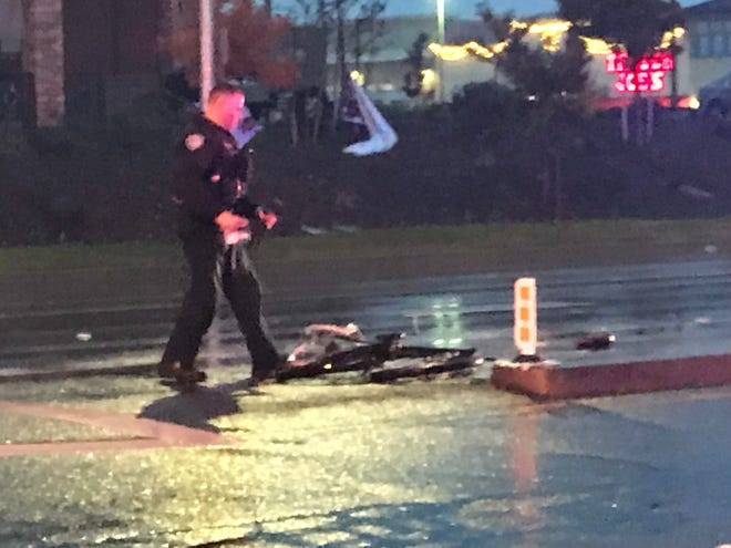 A Redding police officer surveys the Tuesday accident scene at Hilltop Drive and Browning Street.