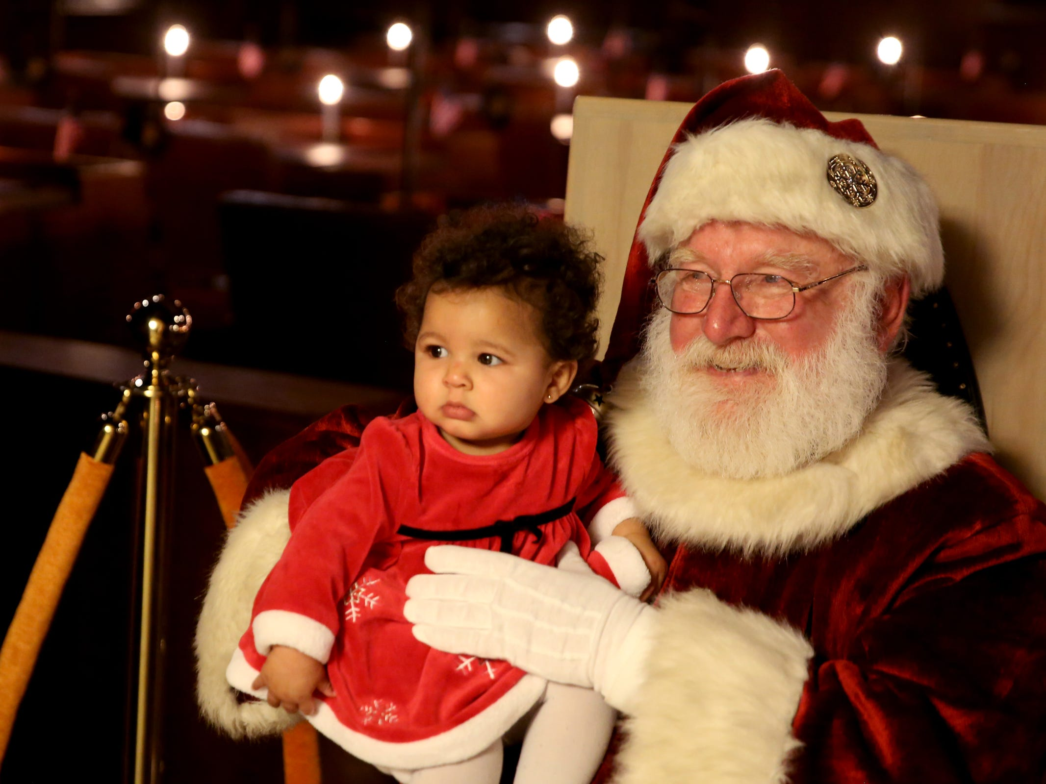 This cutline has been updated with the correct spelling of Hatten. - KaeLynn Hatten, 9 months, of Salem, is held by Santa Claus during the Holiday Tree Lighting Celebration at the Oregon State Capitol in Salem on Tuesday, Nov. 27, 2018.