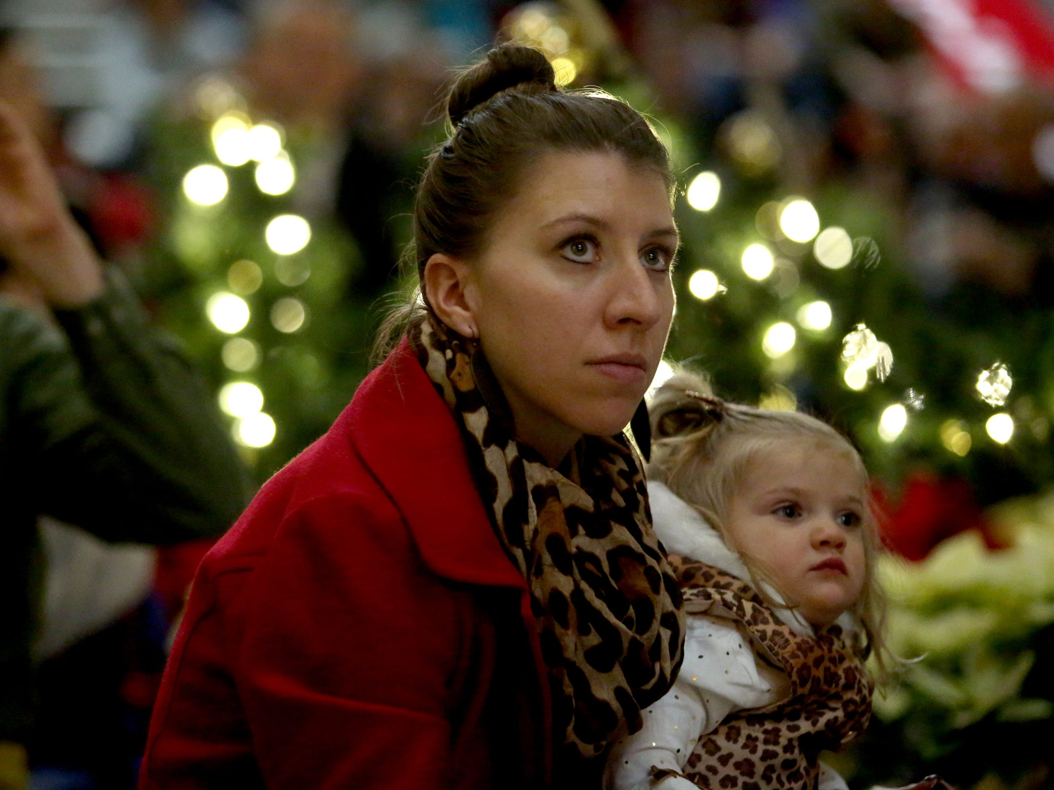 People attend the Holiday Tree Lighting Celebration at the Oregon State Capitol in Salem on Tuesday, Nov. 27, 2018.