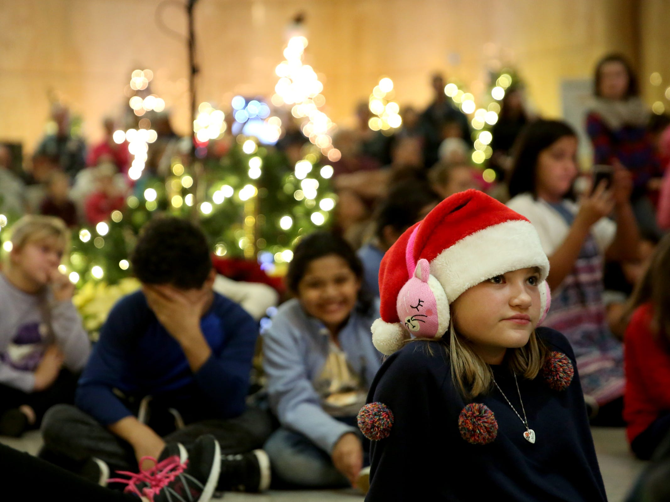 Olivia Weigel, 10, of Turner, attends the Holiday Tree Lighting Celebration at the Oregon State Capitol in Salem on Tuesday, Nov. 27, 2018.