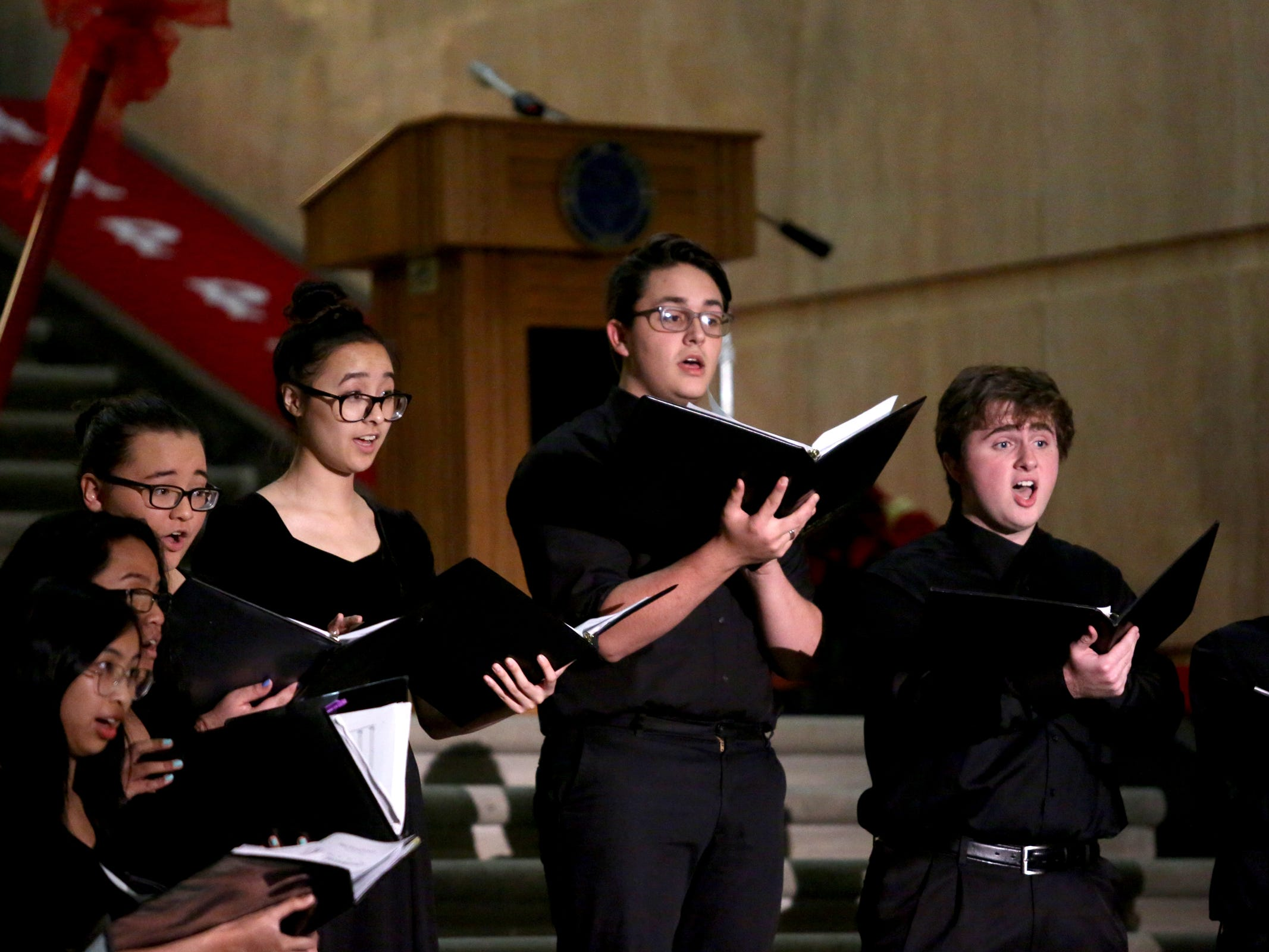 South Salem High School choir students perform during the Holiday Tree Lighting Celebration at the Oregon State Capitol in Salem on Tuesday, Nov. 27, 2018.